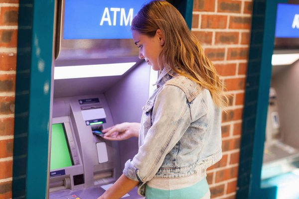 Young Woman at an ATM machine